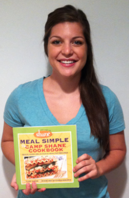 Julie Harrington with cookbook